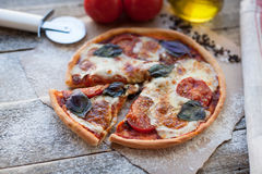 Rustic italian pizza with mozzarella, cheese and basil leaves. Vegetarian food royalty free stock photo
