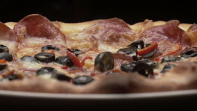 Rustic italian pizza with pepperoni, mozzarella and olive stock footage