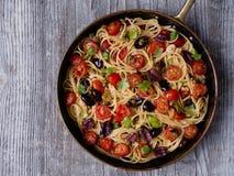 Rustic italian spaghetti puttanesca pasta. Close up of rustic italian spaghetti puttanesca pasta stock photography