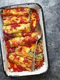 Rustic italian spinach ricotta cannelloni pasta Stock Photo