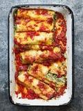Rustic italian spinach ricotta cannelloni pasta Stock Photos