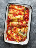 Rustic italian spinach ricotta cannelloni pasta Royalty Free Stock Images