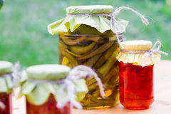 Rustic jars of homemade delicacies Royalty Free Stock Photo
