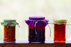 Rustic jars of homemade delicacies Stock Image
