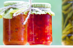 Rustic jars of homemade delicacies. Pickled royalty free stock photos