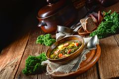Rustic kale soup with meat and sausage Royalty Free Stock Images
