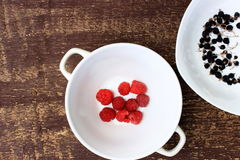 Rustic kitche ware with some berries Stock Images