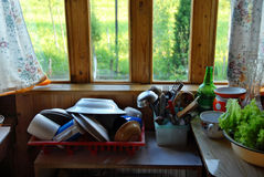 Rustic kitchen. Washed dishes on table in rustic kitchen, still life Stock Photo