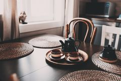Rustic kitchen in brown and grey tones in modern farmhouse or cottage. Morning coffee on wooden table stock image