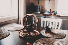 Rustic kitchen in brown and grey tones in modern farmhouse ot cottage. Morning coffee on wooden table royalty free stock images