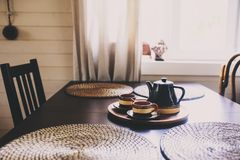 Rustic kitchen in brown and grey tones in modern farmhouse ot cottage. Morning coffee on wooden table stock photography