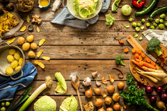 Rustic kitchen, cooking - preparing autumn fall vegetables. Cooking scene - preparing autumn fall vegetables on vintage rustic wooden background. Rural kitchen Stock Photo