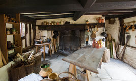 Rustic kitchen. Interior of an ancient country cottage. Rustic kietchen with fireplace Royalty Free Stock Photo