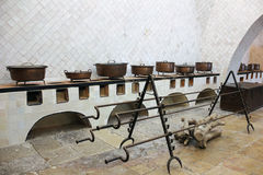 Rustic kitchen. Row of old copper pans. Sintra. Portugal. Row of old copper pans. Sintra. Portugal Royalty Free Stock Photos