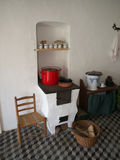 Rustic kitchen with stove. Rustic kitchen from the beginning of 20'th century with wood burning stove Stock Photo