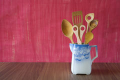 Rustic kitchen utensils in an old jug. Stock Photos