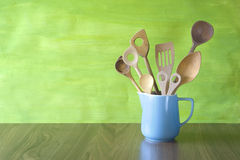 Rustic kitchen utensils in an old jug Stock Photos