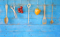Rustic kitchen utensils, vegetables Royalty Free Stock Photography