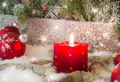 Rustic lantern with candlelights for christmas - classic in red Royalty Free Stock Image