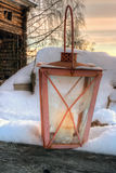Rustic lantern in snow Royalty Free Stock Image