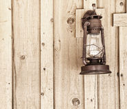 Rustic Lantern on Wood Panel Wall with copy space. Stock Photo