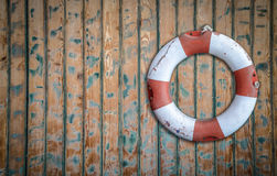 Rustic Lifebuoy On Wall Stock Images