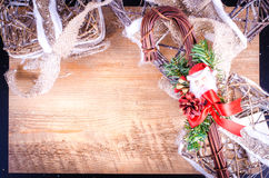 Rustic light boxes on wooden background with Christmas cane Stock Images