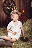 Rustic little girl in white dress Stock Image