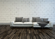 Rustic living room interior with a white sofa Stock Image