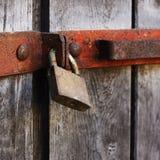 Rustic lock hanging at wooden doors Stock Photography
