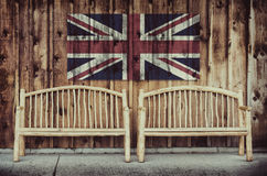 Rustic Log Benches with United Kingdom Flag Stock Photo