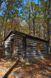 Rustic log cabin in woods Stock Photography