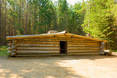 A rustic log dwelling in a forest Stock Photo