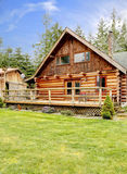 Rustic log small cabin deck exterior. Royalty Free Stock Photography