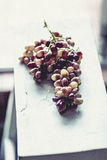 Rustic looking bunch of grapes Stock Photography