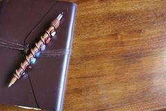 Rustic Leather Notebook with Pen royalty free stock photography