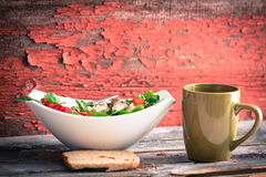 Rustic lunch of spinach salad, tea and bread Royalty Free Stock Photo