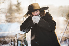 Rustic man in old clothes in the cold winter. Royalty Free Stock Image