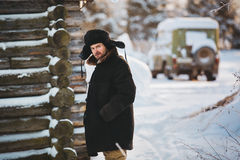 Rustic man in old clothes in the cold winter. Royalty Free Stock Photos