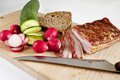 Rustic meal. A rustic meal with vegetables, bacon and bread Royalty Free Stock Image