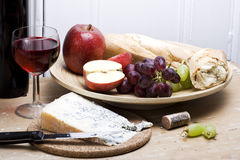 Rustic meal. A rustic still life of a healthy lunch fruit bread wine and cheese Stock Images