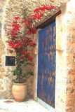 Rustic Mediterranean patio with blooming flowers Royalty Free Stock Photography