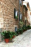 Rustic Mediterranean village street, Spain  Royalty Free Stock Images