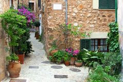 Rustic patio in Mediterranean village Fornalutx, Spain Stock Images