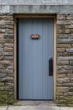 Rustic Mens Room Door. At wayside building Royalty Free Stock Image