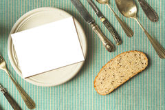 Rustic menu place setting with empty card and golden fork over b Stock Photo