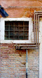Rustic metal pipe and window Stock Photography