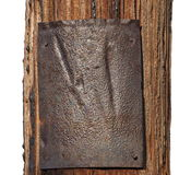 Rustic metal plate on telephone pole isolated Royalty Free Stock Image