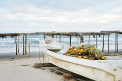 Mexican Fishing Boat on Beach. A rustic Mexican fishing boat with nets on a beach near Tuxpan, Veracruz Stock Photos
