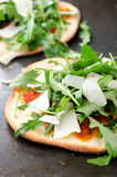 Rustic mini pizzas Stock Photography